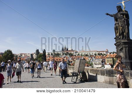 Czechia People And Foreigner Travelers Walking And Visit Old Town Prague City At Charles Bridge Cros