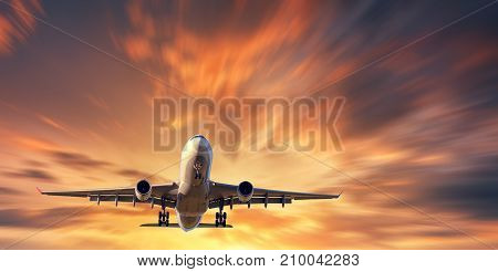 Airplane and beautiful sky with motion blur effect. Landscape with passenger airplane is flying in blurred orange sky with clouds at sunset. Passenger airliner. Commercial aircraft. Private jet