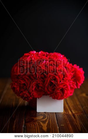Bouquet of red roses on wooden background