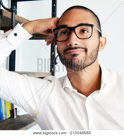 Handsome Latino Man With Glasses Thinking