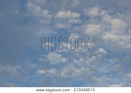 Beautiful puffy clouds and blue sky background