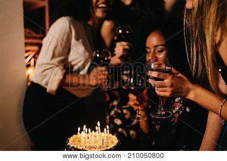 Group of young women celebrating birthday at home