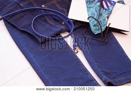 Women's Fashion Accessories And Clothing, Jeans, Belt, Scarf. The Concept Of Shopping And Fashion