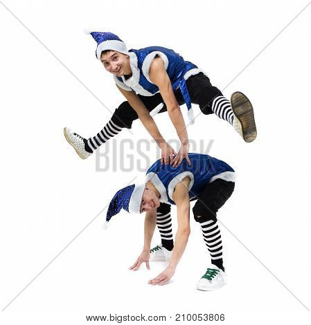 two Christmas men in blue santa clothes dancing against isolated white background in full length.