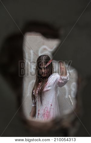 Zombie Or Ghost Woman With Bloody In Hole Cement Broken