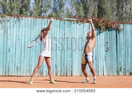 Happy couple of tennis players exercising outdoors. In full growth. The concept of sport.