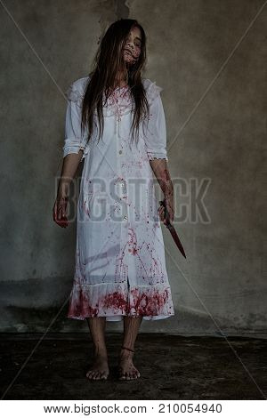 Portrait Zombie Or Ghost Woman With Bloody Holding Knife