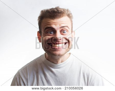 surprised man in a white t shirt on a white background with a cartoon face surprised by discounts shocked facial expression big smile
