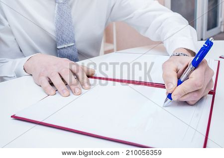 Men Hands With A Pen.