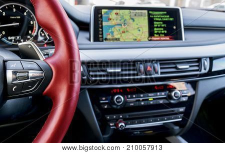 Modern car interior red steering wheel with media phone control buttonsnavigation screen multimedia system background car interior details