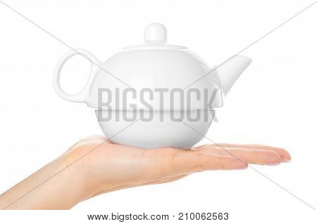 White Ceramic Tea Pot In Hand Isolated On White Background