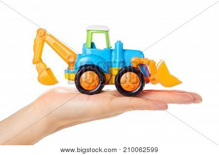 Plastic Toy Tractor In Hand Isolated On White Background