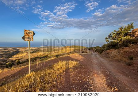 Signposted Dirt Road With View Over Sea On Cyprus Island.