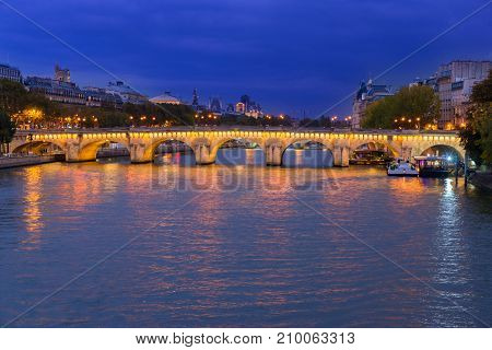 Pont Neuf and river Seine waters at night, Paris, France
