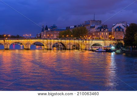 Pont Neuf and Cite island over Seine at night, Paris, France