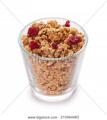 Homemade Granola With Dried Fruits In Glass Cup Isolated On White Background