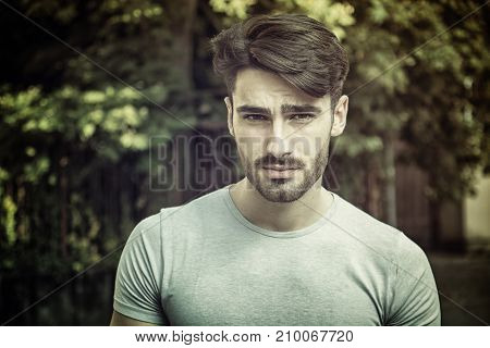 Handsome young man outdoor looking at camera