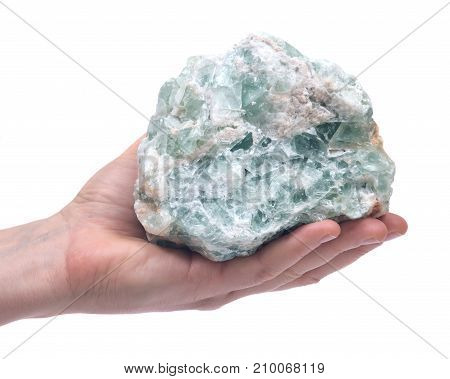 Woman's hand holding Green Apophyllite Cluster in matrix isolated on white background