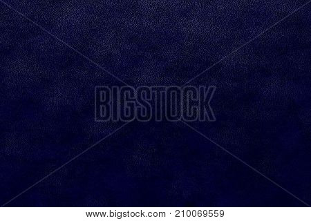 speckled abstract texture of paper or the marble textured background of dark violet color