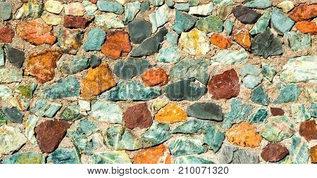 Background texture stone wall of multi-colored stones