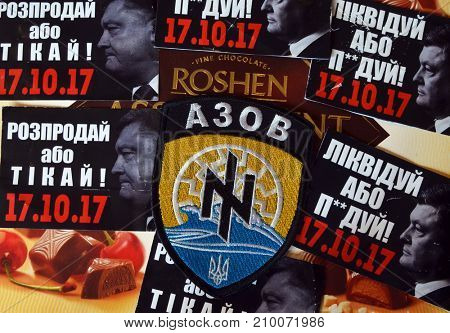 ILLUSTRATIVE EDITORIAL. Chevron of Ukrainian Army.Sticker  Pork -go away (UKR).Protests againstr president Poroshenko. Trademark Roshen is property of Ukrainian president.Kiev,Ukraine.October 18, 2017