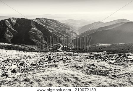 Lift station in Low Tatras mountains. Cable car to the Chopok peak. Valley with coniferous forest. Travelling theme. Natural scene. Black and white photo.
