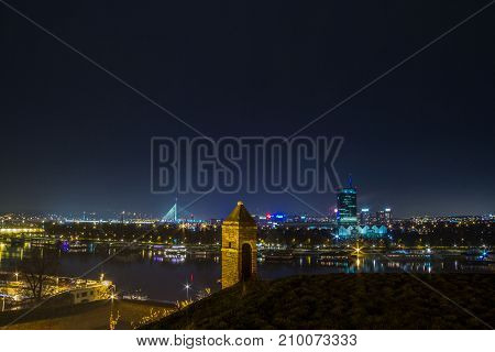 BELGRADE SERBIA - FEBRUARY 01 2015: New Belgrade (Novi Beograd seen by night from the Kalemegdan fortress. The main landmarks of the district such as Ada Most and Usce can be seen