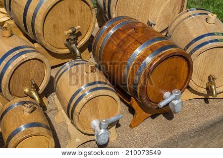 Small wine casks are made with old technology and sold at the fair. 7 oak barrels with hoops.