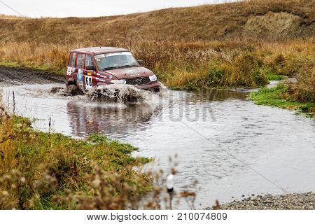 Rally 4X4 Suv Car Overcomes Water Obstacle.
