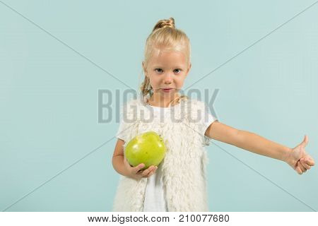 Pretty, Cute Girl In Light Clothes Hold Apples