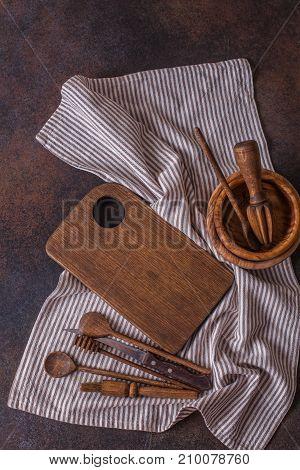 Set Of Wooden Utensils On A Dark Background