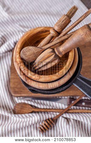 set of wooden utensils on a dark background vertically