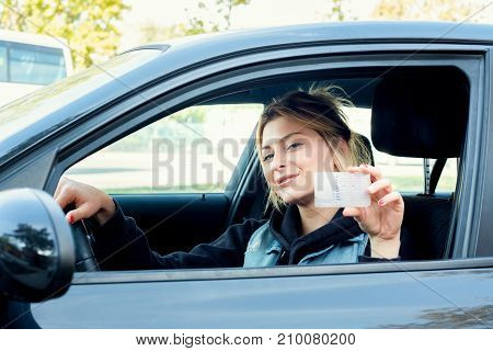 Girl Portrait Sititng In Her Car And Driving License