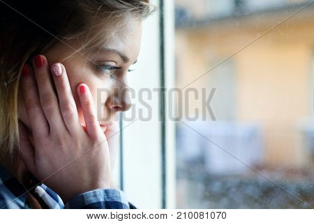 Face Close Up Portrait Of Young Girl Next To Window Glass