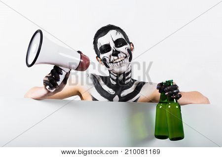 Attractive Girl With Skeleton Makeup Hold Bottle And Megaphone