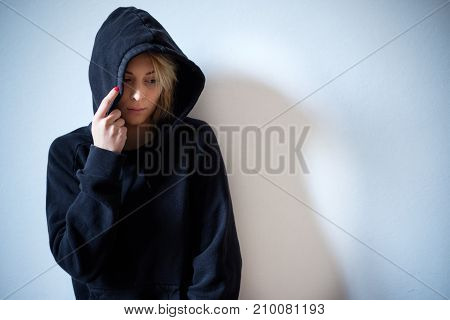Young Girl Hiding Her Face Under Hooded Sweatshirt