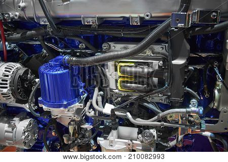 Close up new truck diesel engine motor with different parts details. Truck engine motor filter alternator electronic electric parts. Abstract modern auto automotive industrial background pattern