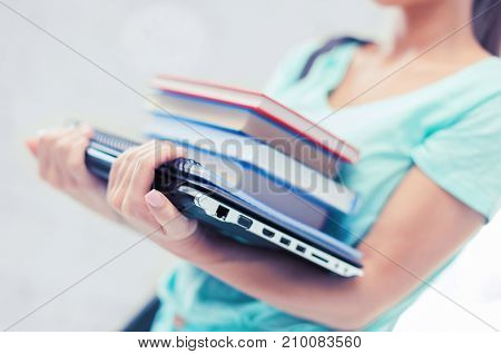 business, office, school and education concept - student with books, computer and folders