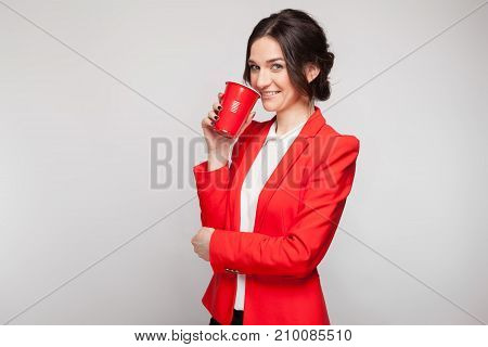 Picture Of Attractive Woman In Red Dress With Cup Of Beer In Hands