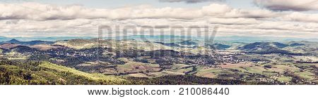 View from the Sitno hill to Stiavnica mountains Slovak republic. Panoramic seasonal natural scene. Autumn country. Old photo filter.