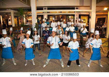 BORACAY, PHILIPHINES-MARCH 19, 2016:Group of chefs dancing in frot of a public restaurant on March 19, 2016. Boracay, Philippines.