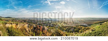 Drazovce village and industrial park Nitra - North in sunset Slovak republic. Autumn panoramic scene. Landscape in middle Europe.