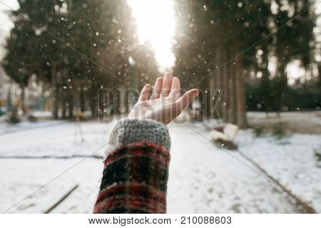 Girls Hand On Nature Background With Snow