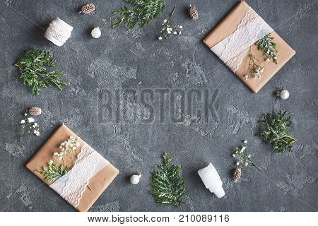 Christmas composition. Christmas gifts and thuja branches on black background. Flat lay top view copy space