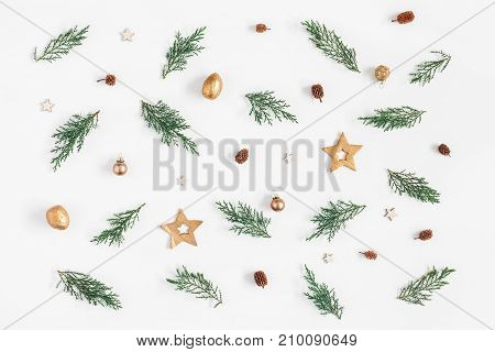 Christmas composition. Pattern made of pine branches and christmas decorations on white background. Flat lay top view