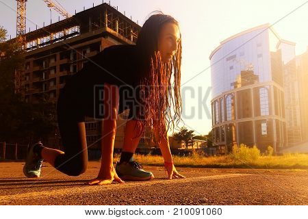 Girl With Dreadlocks On A Low Start