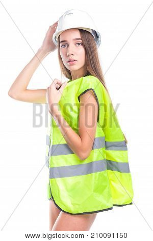 Attractive Young Brunette Woman In Green Builder Vest, Helmet And Black Bikini