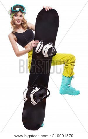 Young Pretty Woman In Black Short Tank Top And Ski Glasses Hold Snowboard
