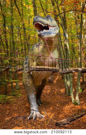 GDANSK, POLAND - OCTOBER 18, 2017: Realistic model of Tyrannosaurus rex in Jurassic Park of Gdansk Oliwa. Dinosaur Park located at the zoo in Gdansk exihibits numerous natural size dinosaurs models.