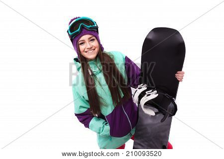 Young Beautiful Woman In Purple Ski Coat And Goggles Hold Snowboard